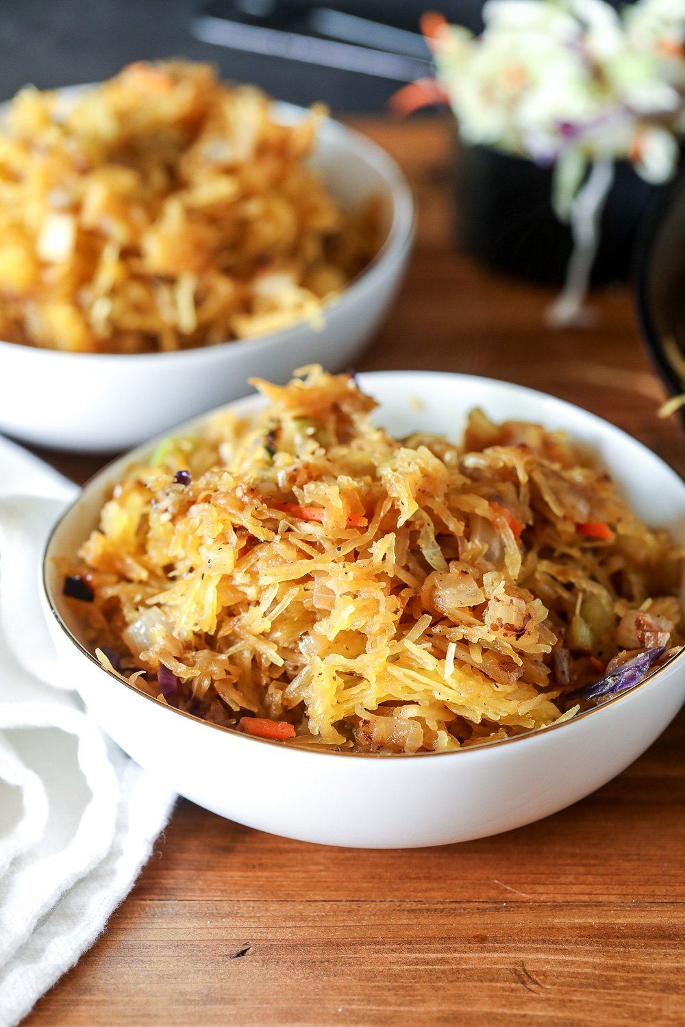 This Spaghetti Squash Chow Mein is so perfect if you are craving noodles but don't want to eat all those carbs! Whole30 and Paleo Compliant.