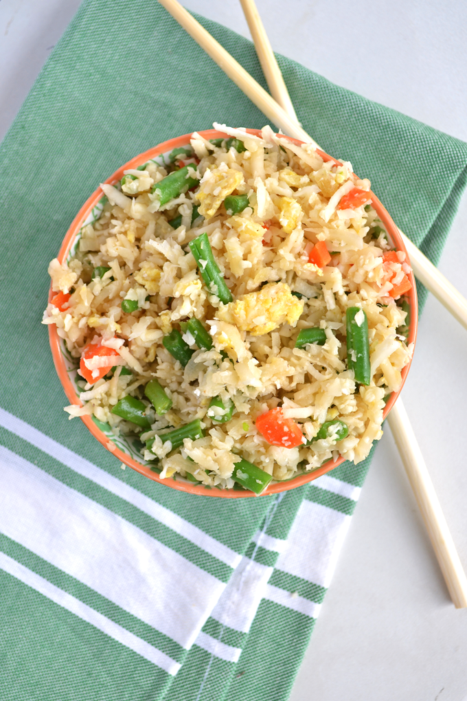 This Cauliflower Fried Rice recipe is paleo & whole30 approved!! Super quick to throw together - click through for a video!