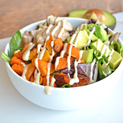 This Paleo Balance Bowl is packed with everything you need to make a perfectly balanced meal in one bowl! Chicken, Butternut Squash & Avocado top greens dressed in a tahini sauce! So tasty and it is paleo & whole 30 approved!