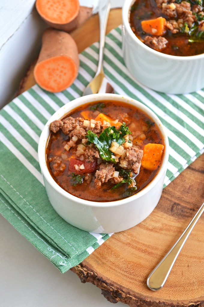 This Italian Beef & Cauliflower Rice Soup is super hearty and filling for any whole 30, paleo or just all around healthy meal! Tons of spices just it great flavor, cauliflower rice adds bulk and sweet potatoes & kale are just the perfect finishing touch!
