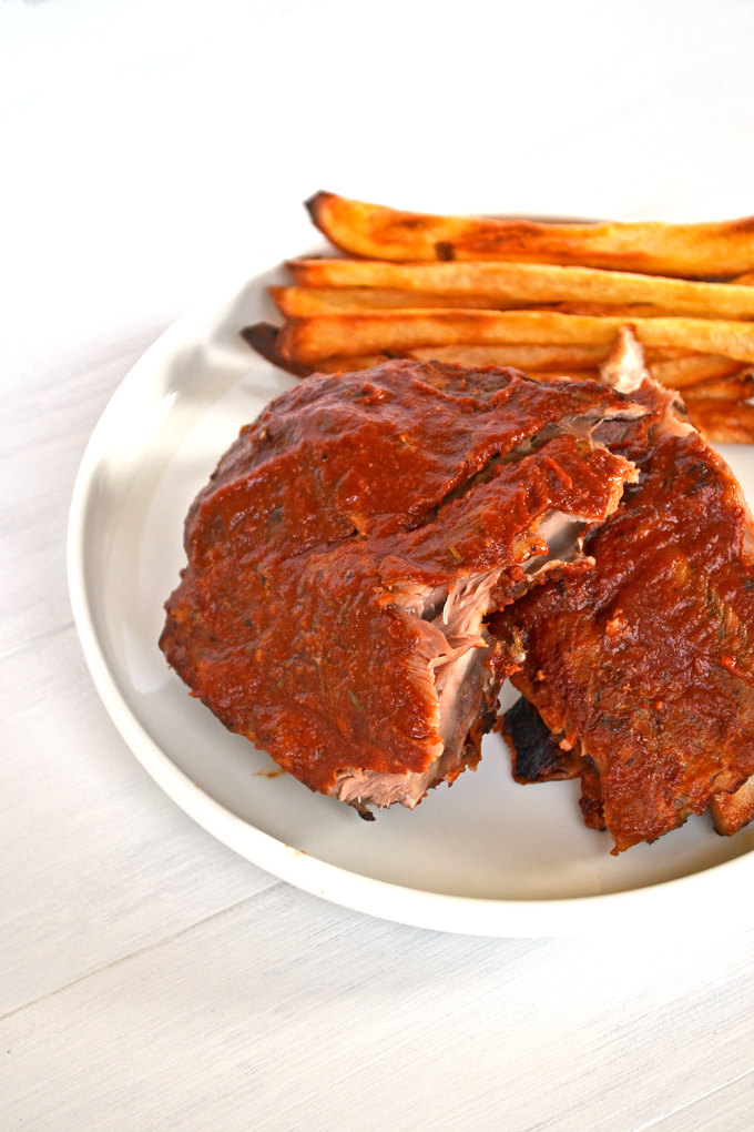 This BBQ Rib recipe is perfect for any time of year! The BBQ Sauce is sugar free, whole30 approved and paleo. The recipe also breaks down the perfect way to achieve fall off the bone ribs!