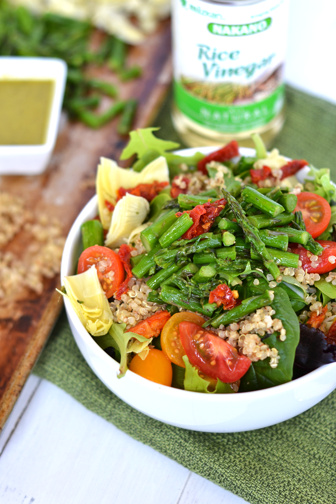 This Asparagus & Quinoa Salad with Pesto Vinaigrette is a simple and perfect salad full of flavor and nutrients! Using Rice Vinegar gives the dressing a perfectly subtle punch!