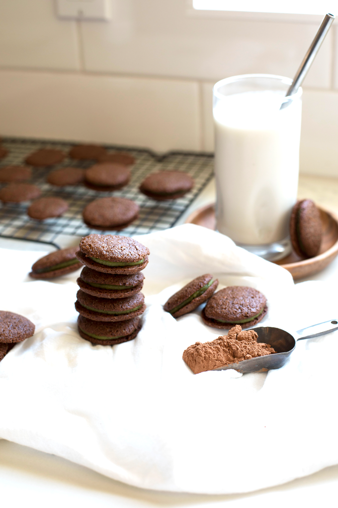 These Grain Free Chocolate Mint Sandwich Cookies are the best treat for any time of year! The filling is sweetened with maple syrup and gets its green color from spinach!