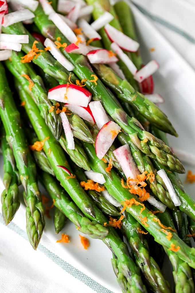 This Orange Ginger Asparagus & Radish Salad is full of spring veggies and delicious flavors. It is also whole30 and super simple!!