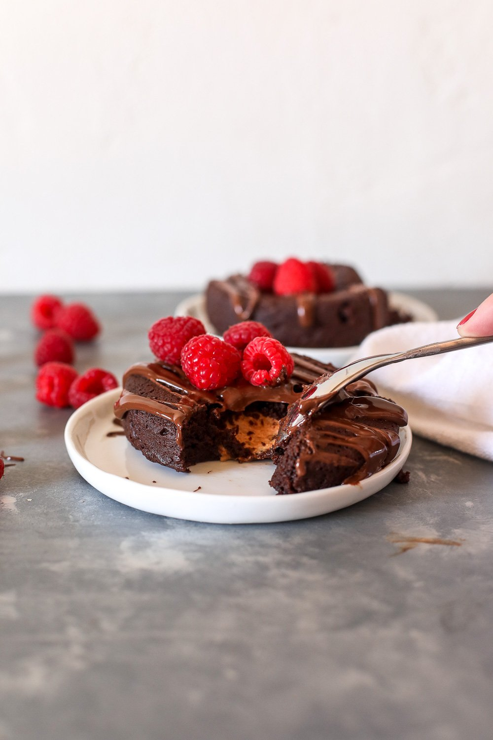 This Nut Butter Stuffed Chocolate Cake is grain free, dairy free and so decadent and delicious for valentine's day!
