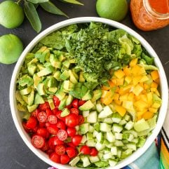 This Fiesta Salad with Salsa Vinaigrette is the perfect side salad with tacos and super easy to make!