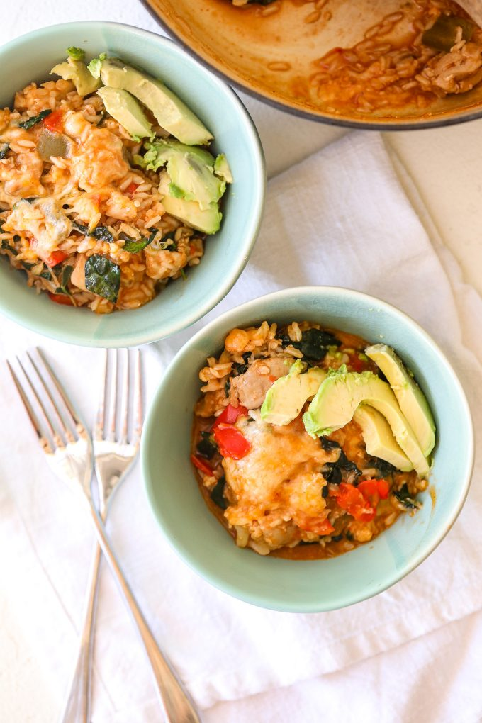 This One-Pot Chicken Enchilada Rice is gluten free and super easy to make on a weeknight. It also has hidden veggies for kiddos!
